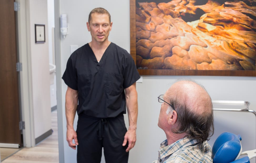 Dr. Shawn B. Davis speaking with a patient.