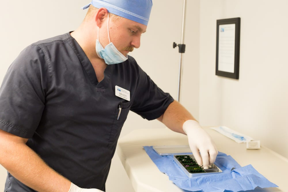 Dental Assistant preparing tray.