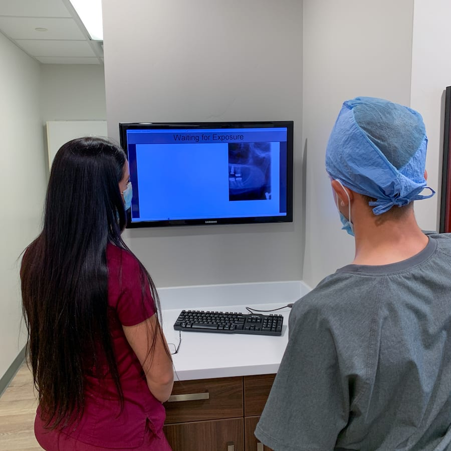 Two Employees Viewing an X-Ray
